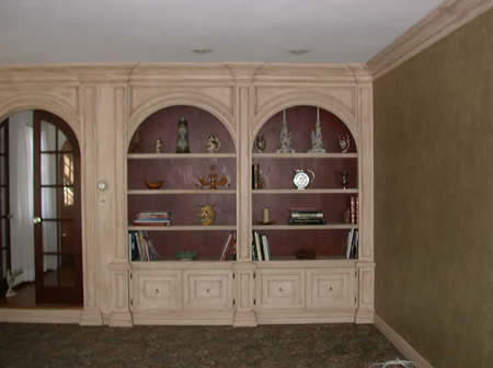 built in wall unit, wall finish,crown moulding.