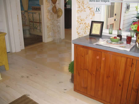Painted floor, faux stone countertop (very durable!).  Nothfork Designer Show House, Jamesport, NY